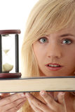 Don't have time to learn. Teenager with book and hourglass Stock Photography