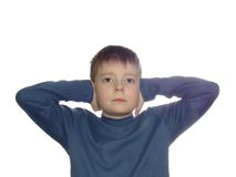 Don't hear. Boy closing his ears with palms isolated over white bacground Royalty Free Stock Image
