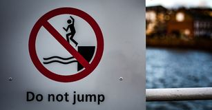 Don`t Jump Sign. Public information sign warning not to jump from a quay-side; English seaside resort, harbour royalty free stock image