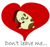 Don't leave me. Sad little dog in big red heart Stock Images