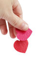 Don't let my heart get away. Hand holding hearts, one is dropping stock photography