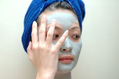 Don't look. Woman trying to hide the mask on face Stock Photos