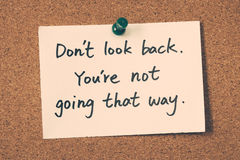 Don't look back. You're not going that way. Note pin on the bulletin board royalty free stock images