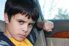 Don't Mess with Me!. Child threatening someone with his fist. He is ready to fight to defend himself Stock Image