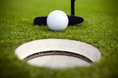 Don't Miss!. A golfer attempts to make a very short putt royalty free stock image