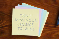 Don't miss your chance to win written on a note Royalty Free Stock Photography