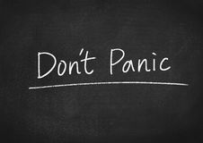 Don`t panic. Concept text on blackboard background Royalty Free Stock Photography
