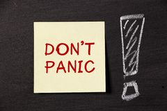 Don't Panic!. Don't Panic note with big exclamation mark on blackboard Royalty Free Stock Photo