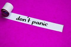 Don`t Panic text, Inspiration, Motivation and business concept on purple torn paper royalty free stock image