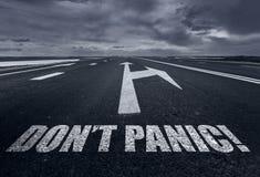 Don`t Panic written on desert road. Toned Royalty Free Stock Image