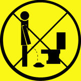 Don't Pee on Floor Warning Sign. A sign warning against not peeing on the floor. I have designed and created the sign myself. Isolated on black and yellow Royalty Free Stock Images