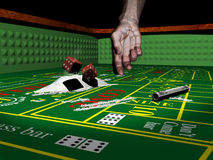 Don't play with drugs. A half skeleton hand that has launched two dices over some cocaine on a craps table Stock Images