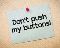 Don't push my buttons!. Message. Recycled paper note pinned on cork board. Concept Image stock photos