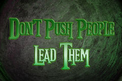 Don't Push People Lead Them Concept Stock Photo