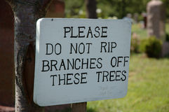 Don't rip branches. A sign stating please do not rip branches off these trees stock photos