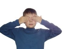 Don't see. Boy closing his eyes with palms isolated over white bacground Stock Images
