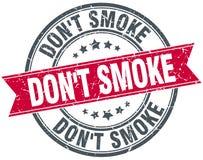 Don`t smoke red round grunge vintage stamp. Don`t smoke red round grunge vintage ribbon stamp Stock Photography