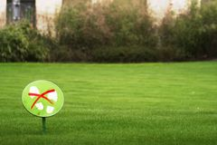 Don't step on the grass. A sign says not to step on the grass royalty free stock image