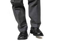 Don�t step on your own shoeslaces!. Business man standing on his own laces Stock Image