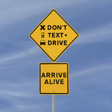 Don't Text & Drive!. Modified road sign warning of the danger of texting and driving (against a blue sky background Stock Images