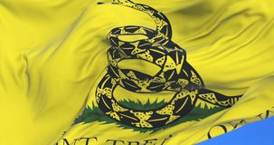 Gadsden Don`t Tread On Me Flag waving at wind in slow with blue sky, loop. Don`t Tread On Me Gadsden Flag waving at wind in slow with blue sky, looped