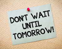 Don't Wait Until Tomorrow Motivational Message. Recycled paper note pinned on cork board.Don't Wait Until Tomorrow Message. Motivational Concept Image Stock Photography