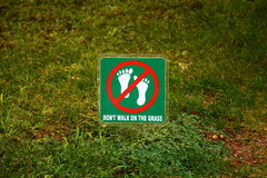 Don't walk on the grass Royalty Free Stock Images