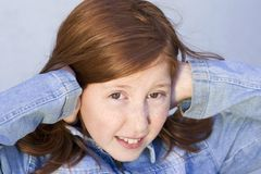 Don't want to listen. Girl closing ears with her hands Royalty Free Stock Photo