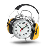 Don't want to wake up. Alarm clock ringing with hear protectors isolated, wake-up concept Royalty Free Stock Photo