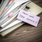 Don`t Work Too Hard; The Pile of Business Documents on the Desk Royalty Free Stock Photography