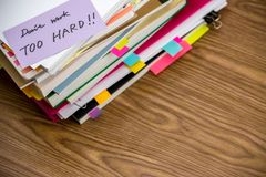 Don`t Work Too Hard; The Pile of Business Documents on the Desk Royalty Free Stock Images