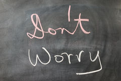 Don't worry. Words written on the chalkboard Stock Photos