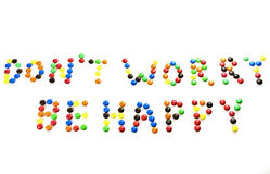 Don't worry, be happy. The phrase 'Don't worry, be happy' written with sugar-coated candy Royalty Free Stock Photos
