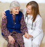 Don't worry be happy. Old woman tells a story to the young doctor Royalty Free Stock Photos