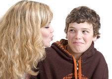 Don't you dare. Girl teasing her brother by puckering for a kiss Royalty Free Stock Photos