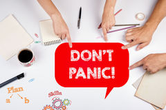 DON'T PANIC! The meeting at the white office table Stock Photo
