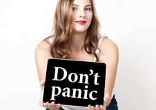 Don't panic written on virtual screen. technology, internet and networking concept. beautiful woman with bare shoulders Royalty Free Stock Photography