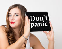 Don't panic written on virtual screen. technology, internet and networking concept. beautiful woman with bare shoulders Royalty Free Stock Images