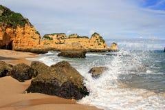 Dona Ana Beach, Lagos, Portugal. Dona Ana Beach in Lagos with waves splashing on rocks, Algarve, Portugal Royalty Free Stock Image