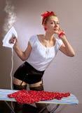 Dona de casa com ferro Imagem de Stock Royalty Free