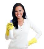 Dona de casa feliz com líquido de limpeza de indicador. Imagens de Stock