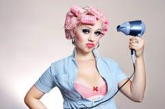 Dona de casa infeliz com hairdryer imagens de stock royalty free