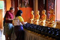 Donación para su estatua de Buda del cumpleaños Imagen de archivo libre de regalías