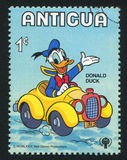 Donald car. ANTIGUA - CIRCA 1980: stamp printed by Antigua, shows Disney Characters, Donald, car, circa 1980 stock image