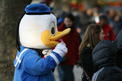 Donald Duck / Profile. Street performer in Donald Duck costume tries to attract people. Picture taken in London, near London Eye Royalty Free Stock Images