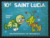 Donald Duck, space creature. SAINT LUCIA - CIRCA 1980: stamp printed by Saint Lucia, shows shows Walt Disney Characters, Space scenes, Donald Duck, space stock photos