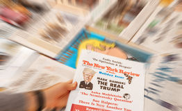Donald Trump inauguratiom The New York review. PARIS, FRANCE - JAN 21, 2017: Man holding The New york Review above major international newspaper journalism royalty free stock photos