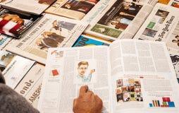 Donald Trump inauguration by major international newspaper journalism. PARIS, FRANCE - JAN 21, 2017: The New York Review magazine above major international stock images