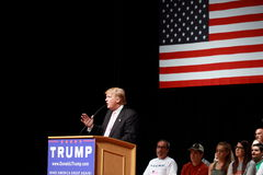 Donald Trump speaks at campaign rally on July, 25, 2015, in Oskaloosa, Iowa. Supporters and American flag in background stock image