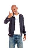 Donante africano feliz del hombre pulgares para arriba Imagen de archivo libre de regalías